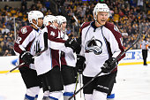 Jamie McGinn of the Colorado Avalanche celebrates a goal with his teammates against the Boston Bruins at the TD Garden on October 13 2014 in Boston...