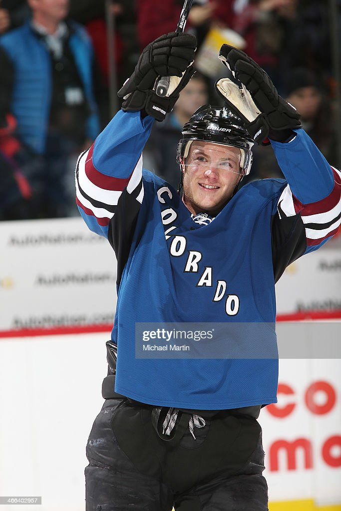 <a gi-track='captionPersonalityLinkClicked' href=/galleries/search?phrase=Jamie+McGinn&family=editorial&specificpeople=537964 ng-click='$event.stopPropagation()'>Jamie McGinn</a> #11 of the Colorado Avalanche celebrates a win against the Buffalo Sabres at the Pepsi Center on February 1, 2014 in Denver, Colorado. The Avalanche defeated the Sabres 7-1.