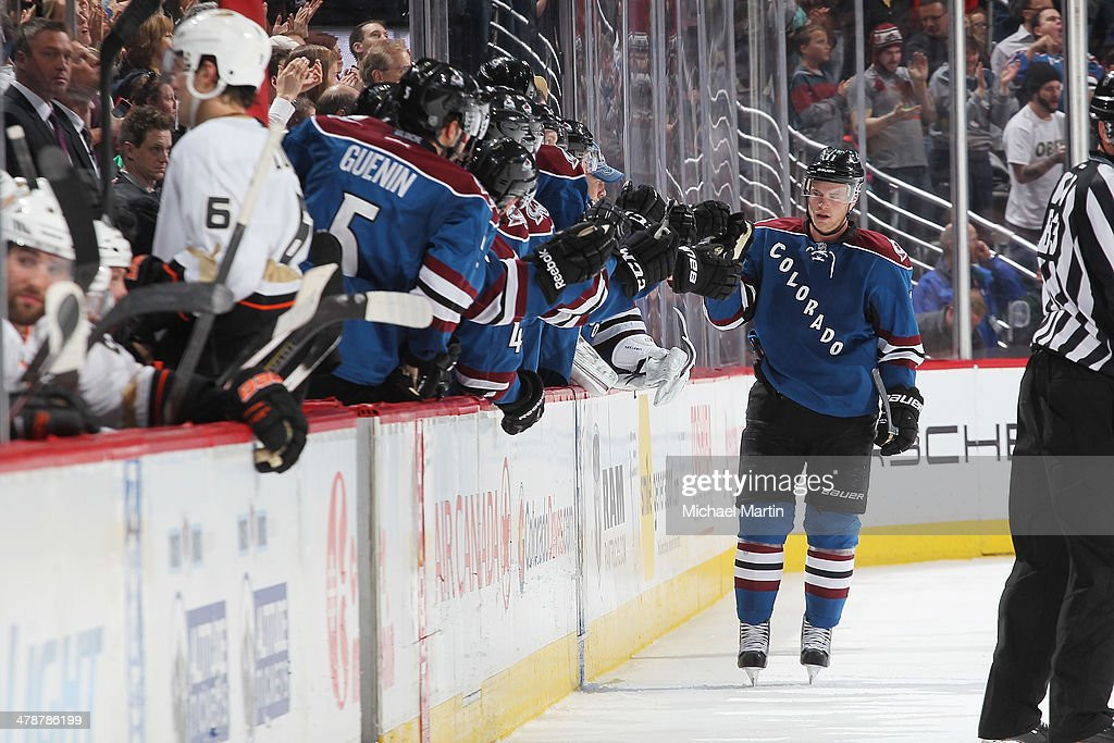 <a gi-track='captionPersonalityLinkClicked' href=/galleries/search?phrase=Jamie+McGinn&family=editorial&specificpeople=537964 ng-click='$event.stopPropagation()'>Jamie McGinn</a> #11 of the Colorado Avalanche is congratulated by teammates after scoring against the Anaheim Ducks at the Pepsi Center on March 14, 2014 in Denver, Colorado.