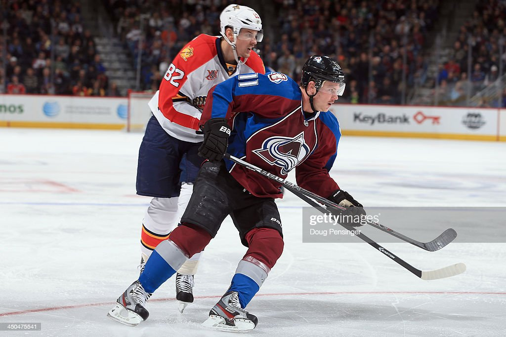 Jamie McGinn #11 of the Colorado Avalanche skates against Tomas Kopecky #82 of the Florida Panthers at Pepsi Center on November 16, 2013 in Denver, Colorado. The Panthers defeated the Avalanche 4-1.