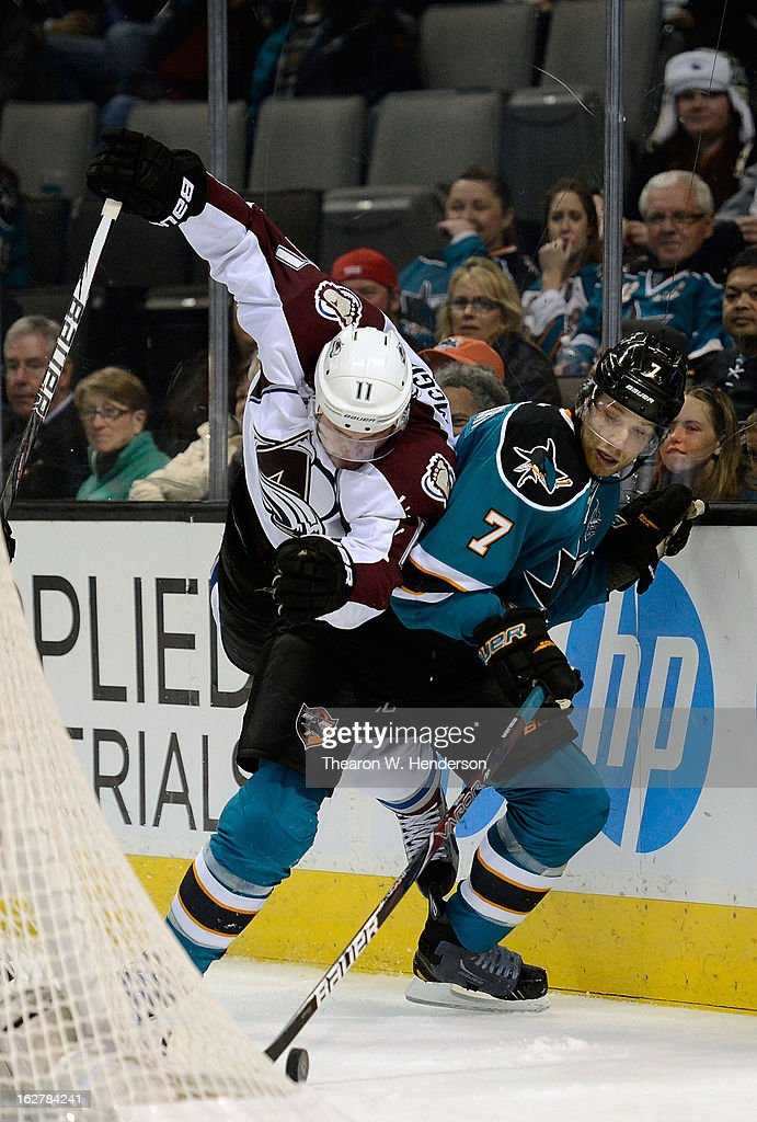 <a gi-track='captionPersonalityLinkClicked' href=/galleries/search?phrase=Jamie+McGinn&family=editorial&specificpeople=537964 ng-click='$event.stopPropagation()'>Jamie McGinn</a> #11 of the Colorado Avalanche skating to gain control of the puck collides with <a gi-track='captionPersonalityLinkClicked' href=/galleries/search?phrase=Brad+Stuart+-+Ice+Hockey+Player&family=editorial&specificpeople=213995 ng-click='$event.stopPropagation()'>Brad Stuart</a> #7 of the San Jose Shark in the third period at HP Pavilion on February 26, 2013 in San Jose, California. The Sharks won the game in an overtime shoot-out 3-2.