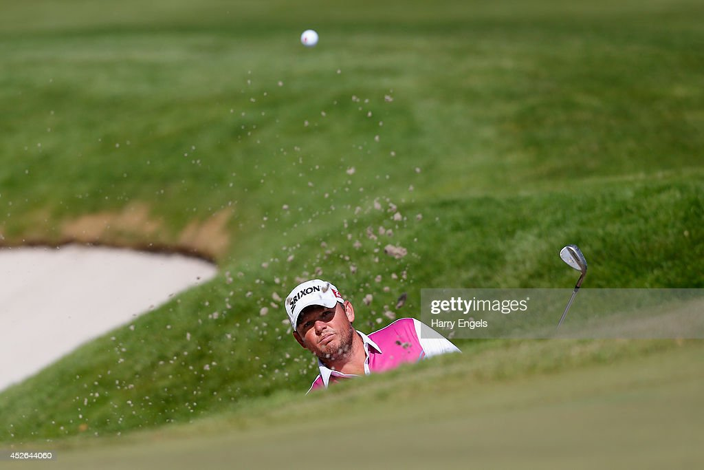 Jamie McLeary of Scotland hits out of a bunker at the fourteenth on day two of the M2M Russian Open at Tseleevo Golf & Polo Club on July 25, 2014 in Moscow, Russia.
