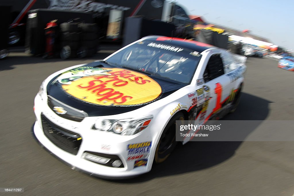 Jamie McMurray, driver of the #1 Bass Pro Shops/McDonald's Chevrolet, drives to the garage area during practice for the NASCAR Sprint Cup Series Auto Club 400 at Auto Club Speedway on March 23, 2013 in Fontana, California.