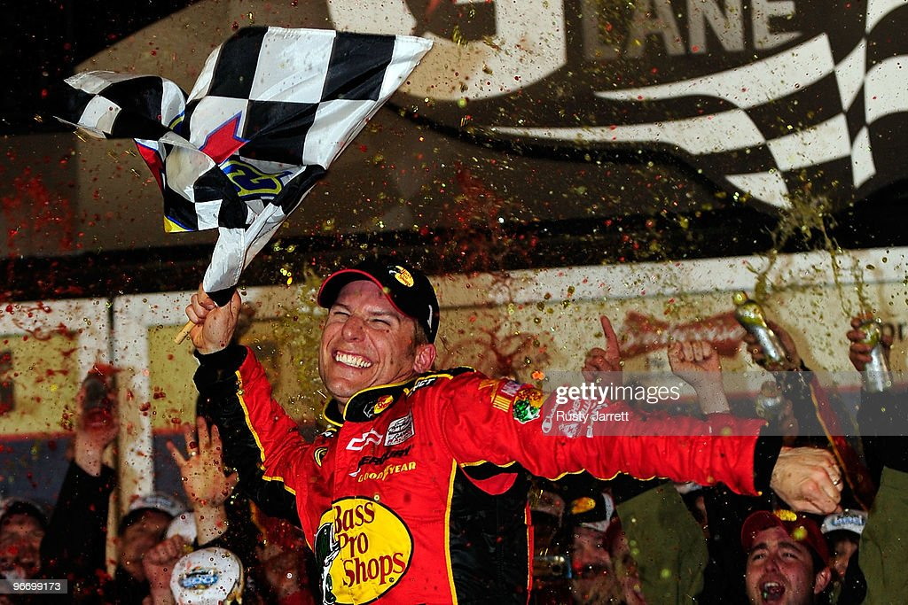 <a gi-track='captionPersonalityLinkClicked' href=/galleries/search?phrase=Jamie+McMurray&family=editorial&specificpeople=198964 ng-click='$event.stopPropagation()'>Jamie McMurray</a>, driver of the #1 Bass Pro Shops/Tracker Boats Chevrolet, celebrates in Victory Lane after winning the NASCAR Sprint Cup Series Daytona 500 at Daytona International Speedway on February 14, 2010 in Daytona Beach, Florida.
