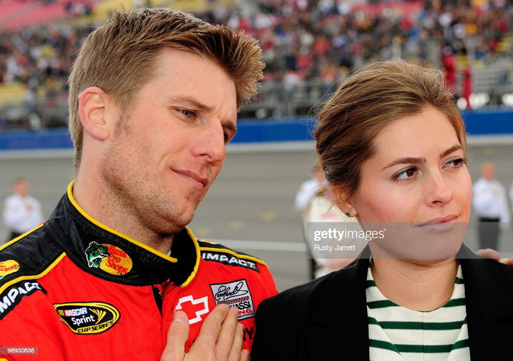 <a gi-track='captionPersonalityLinkClicked' href=/galleries/search?phrase=Jamie+McMurray&family=editorial&specificpeople=198964 ng-click='$event.stopPropagation()'>Jamie McMurray</a>, driver of the Bass Pro Shops/Tracker Boats Chevrolet, and wife Christy look on from pit road prior to the start of the NASCAR Sprint Cup Series Auto Club 500 at Auto Club Speedway on February 21, 2010 in Fontana, California.