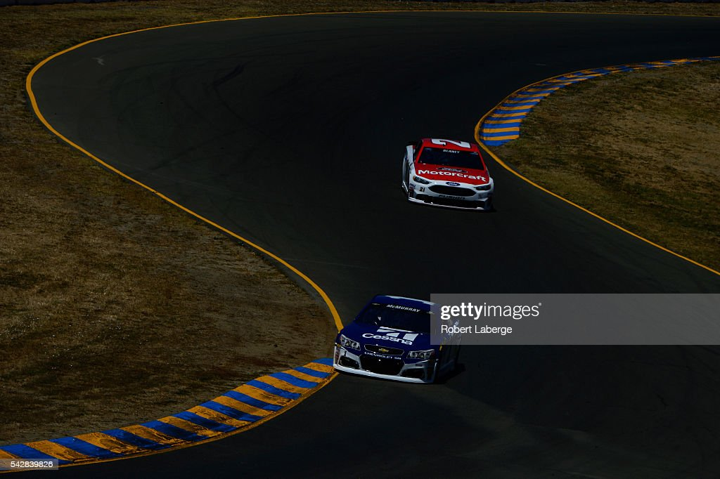 <a gi-track='captionPersonalityLinkClicked' href=/galleries/search?phrase=Jamie+McMurray&family=editorial&specificpeople=198964 ng-click='$event.stopPropagation()'>Jamie McMurray</a>, driver of the #1 Cessna Chevrolet, and <a gi-track='captionPersonalityLinkClicked' href=/galleries/search?phrase=Ryan+Blaney&family=editorial&specificpeople=8626930 ng-click='$event.stopPropagation()'>Ryan Blaney</a>, driver of the #21 Motorcraft/Quick Lane Tire & Auto Center Ford, drive during practice for the NASCAR Sprint Cup Series Toyota/Save Mart 350 at Sonoma Raceway on June 24, 2016 in Sonoma, California.