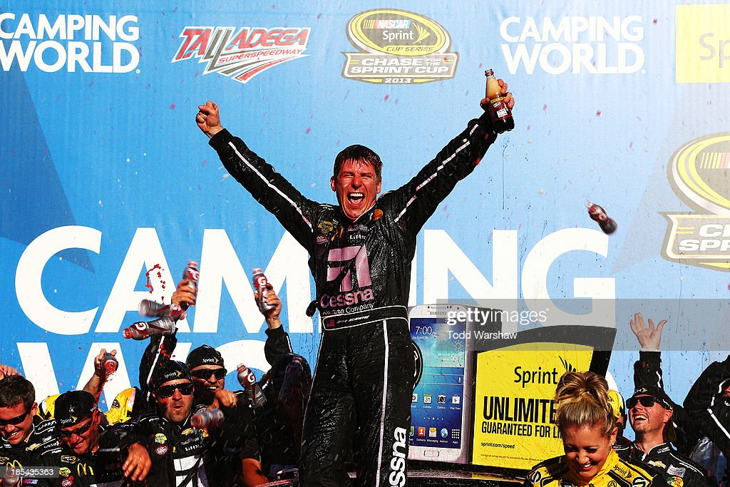 Jamie McMurray, driver of the #1 Cessna Chevrolet, celebrates in Victory Lane after winning the NASCAR Sprint Cup Series Camping World RV Sales 500 at Talladega Superspeedway on October 20, 2013 in Talladega, Alabama.