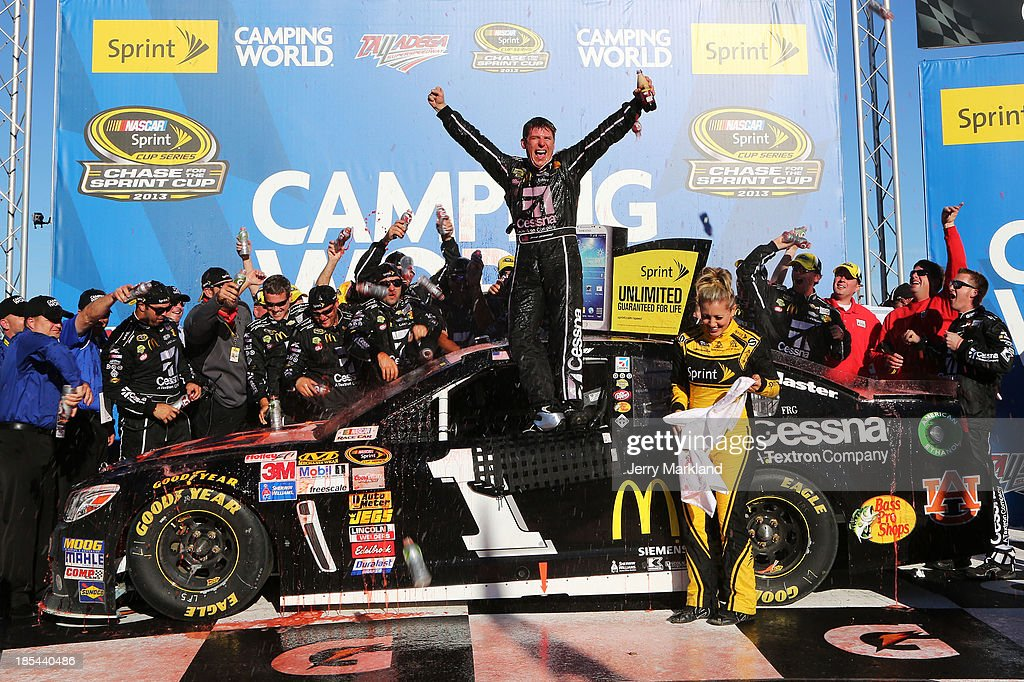 Jamie McMurray, driver of the #1 Cessna Chevrolet, celebrates in Victory Lane with crew members after winning the NASCAR Sprint Cup Series Camping World RV Sales 500 at Talladega Superspeedway on October 20, 2013 in Talladega, Alabama.