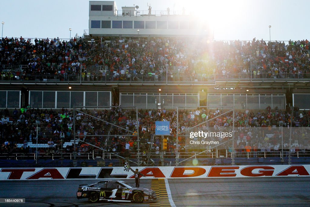 Jamie McMurray, driver of the #1 Cessna Chevrolet, celebrates on track with the checkered flag after winning the NASCAR Sprint Cup Series Camping World RV Sales 500 at Talladega Superspeedway on October 20, 2013 in Talladega, Alabama.