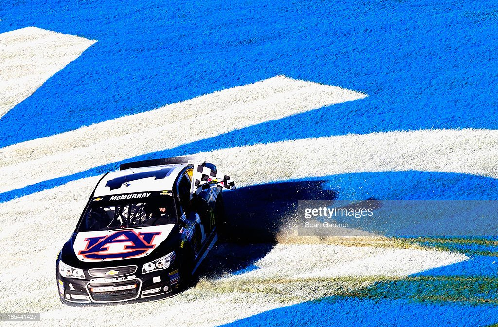 Jamie McMurray, driver of the #1 Cessna Chevrolet, celebrates on track after winning the NASCAR Sprint Cup Series Camping World RV Sales 500 at Talladega Superspeedway on October 20, 2013 in Talladega, Alabama.