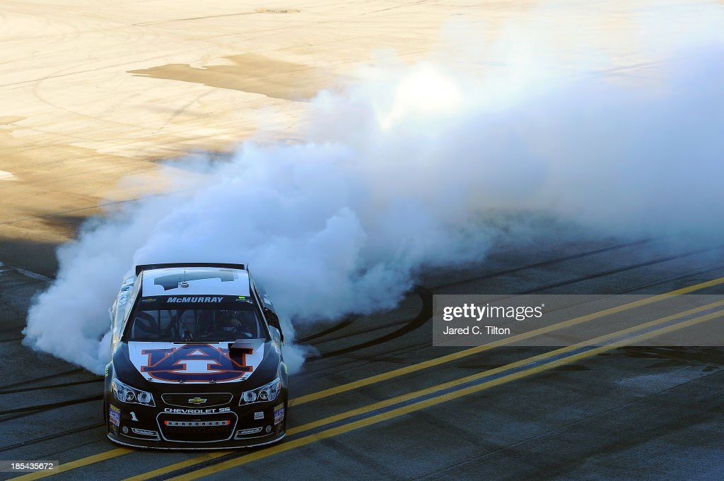 <a gi-track='captionPersonalityLinkClicked' href=/galleries/search?phrase=Jamie+McMurray&family=editorial&specificpeople=198964 ng-click='$event.stopPropagation()'>Jamie McMurray</a>, driver of the #1 Cessna Chevrolet, celebrates with a burnout after winning the NASCAR Sprint Cup Series Camping World RV Sales 500 at Talladega Superspeedway on October 20, 2013 in Talladega, Alabama.