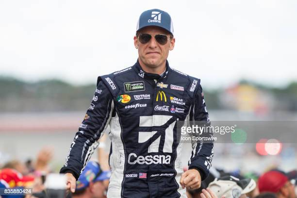 Jamie McMurray driver of the Cessna Chevrolet greets fans during the prerace ceremonies of the Monster Energy NASCAR Cup Series Pure Michigan 400...