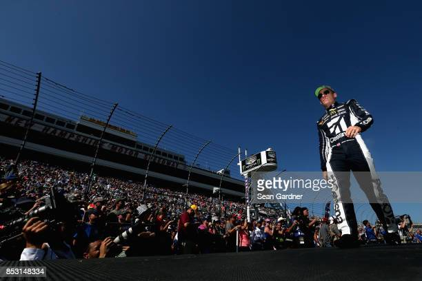 Jamie McMurray driver of the Cessna Chevrolet is introduced during prerace ceremonies for the Monster Energy NASCAR Cup Series ISM Connect 300 at New...