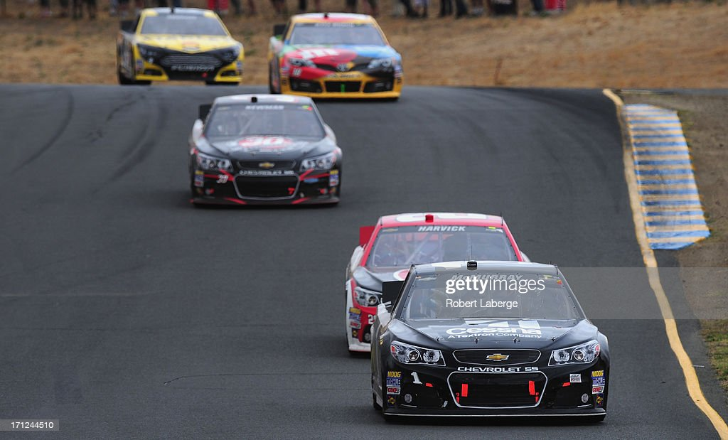 Jamie McMurray, driver of the #1 CESSNA Chevrolet, leads a pack of cars during the NASCAR Sprint Cup Series Toyota/Save Mart 350 at Sonoma Raceway on June 23, 2013 in Sonoma, California.