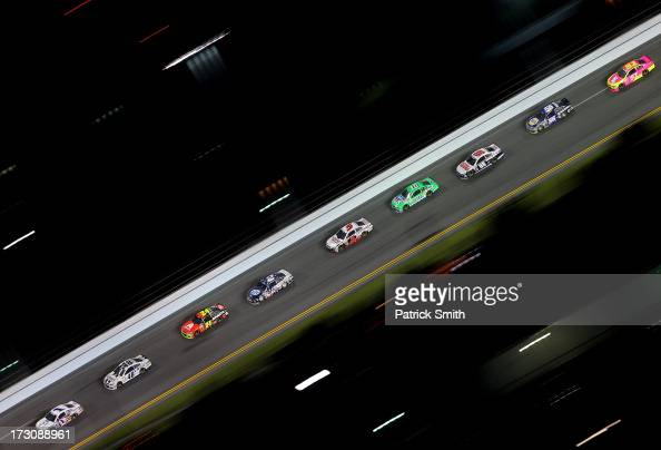 Jamie McMurray driver of the Cessna Chevrolet leads a pack of cars during the NASCAR Sprint Cup Series Coke Zero 400 at Daytona International...