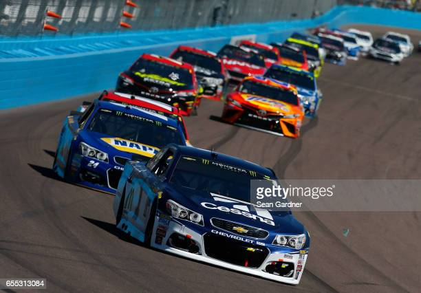 Jamie McMurray driver of the Cessna Chevrolet leads a pack of cars during the Monster Energy NASCAR Cup Series Camping World 500 at Phoenix...