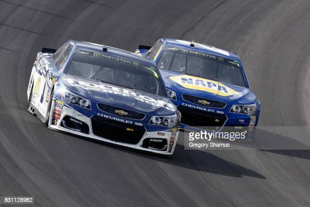 Jamie McMurray driver of the Cessna Chevrolet leads Chase Elliott driver of the NAPA Chevrolet during the Monster Energy NASCAR Cup Series Pure...