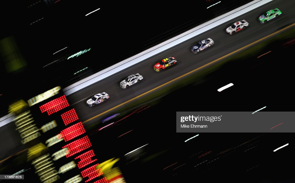 Jamie McMurray, driver of the #1 Cessna Chevrolet, leads Jimmie Johnson, driver of the #48 Lowe's Dover White Chevrolet, during the NASCAR Sprint Cup Series Coke Zero 400 at Daytona International Speedway on July 6, 2013 in Daytona Beach, Florida.