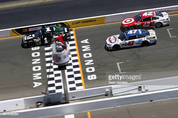 Jamie McMurray driver of the Cessna Chevrolet leads the field at the start of the NASCAR Sprint Cup Series Toyota/Save Mart 350 at Sonoma Raceway on...