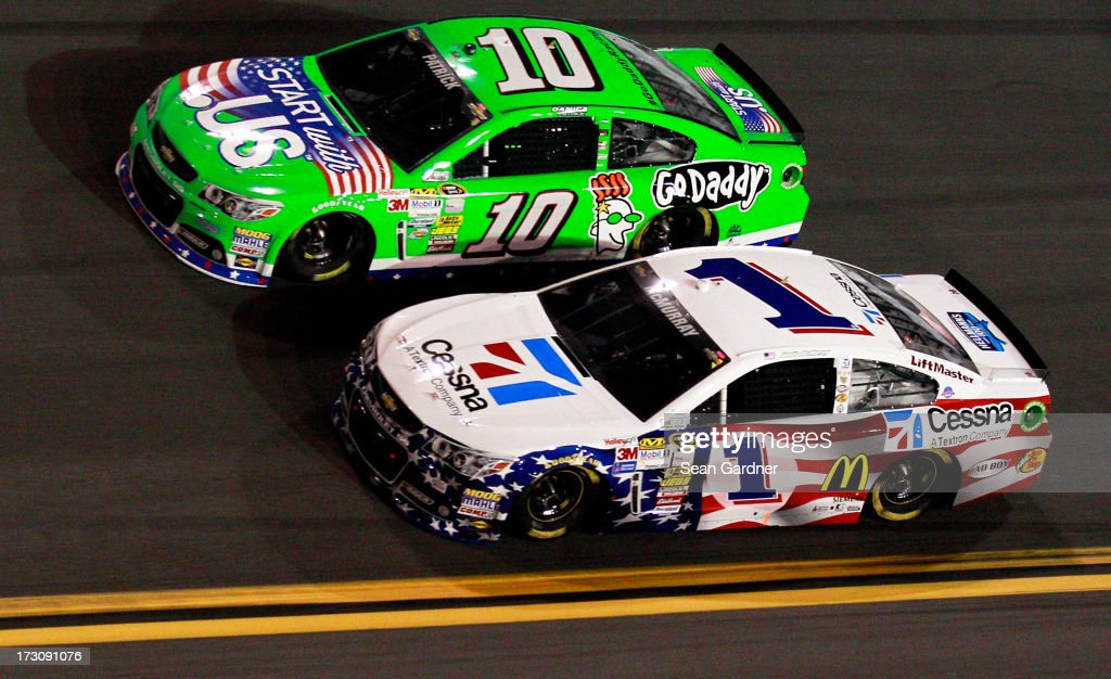 Jamie McMurray, driver of the #1 Cessna Chevrolet, races Danica Patrick, driver of the #10 GoDaddy.com Chevrolet, during the NASCAR Sprint Cup Series Coke Zero 400 at Daytona International Speedway on July 6, 2013 in Daytona Beach, Florida.