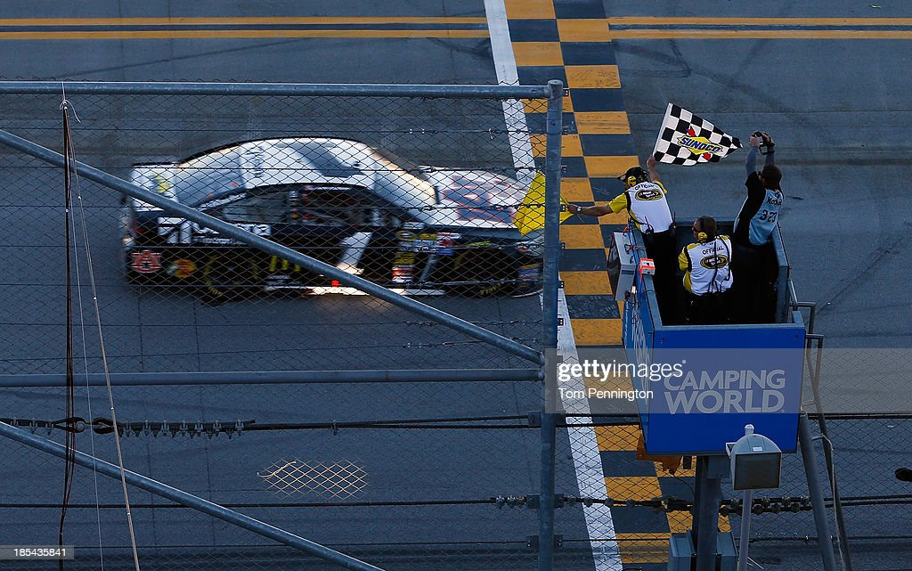 Jamie McMurray, driver of the #1 Cessna Chevrolet, races to the checkered flag to win the NASCAR Sprint Cup Series Camping World RV Sales 500 at Talladega Superspeedway on October 20, 2013 in Talladega, Alabama.