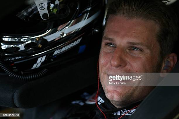 Jamie McMurray driver of the Cessna Chevrolet sits in his car during practice for the NASCAR Sprint Cup Series OralB USA 500 at Atlanta Motor...