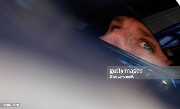 Jamie McMurray driver of the Cessna Chevrolet sits in his car during practice for the Monster Energy NASCAR Cup Series Camping World 500 at Phoenix...