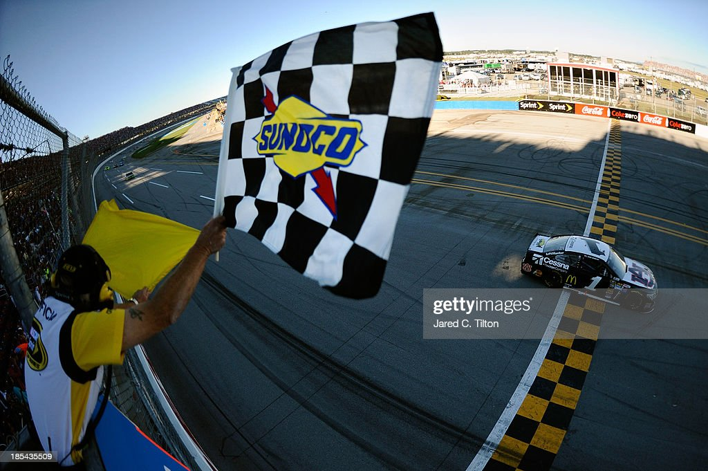 Jamie McMurray, driver of the #1 Cessna Chevrolet, takes the checkered flag to win the NASCAR Sprint Cup Series Camping World RV Sales 500 at Talladega Superspeedway on October 20, 2013 in Talladega, Alabama.