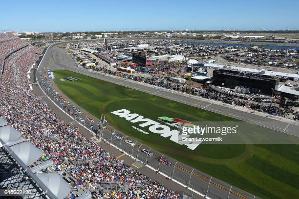 Jamie McMurray driver of the Cessna McDonald's Chevrolet leads a pack of cars during the 59th Annual DAYTONA 500 at Daytona International Speedway on...