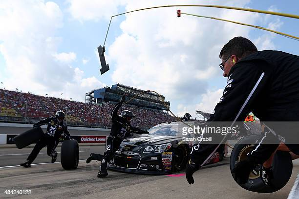 Jamie McMurray driver of the Cessna/McDonald's Chevrolet pits during the NASCAR Sprint Cup Series Pure Michigan 400 at Michigan International...
