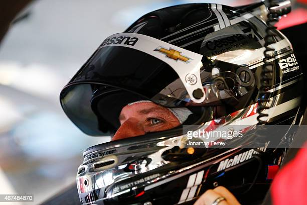 Jamie McMurray driver of the Cessna/McDonald's Chevrolet sits in his car during practice for the NASCAR Sprint Cup Series 57th Annual Daytona 500 at...
