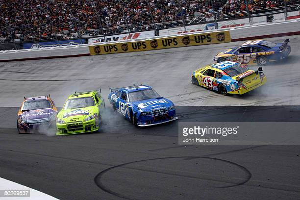 Jamie McMurray driver of the Crown Royal Ford spins out with Paul Menard driver of the Menards/Peak Chevrolet Ryan Newman driver of the alltel Dodge...