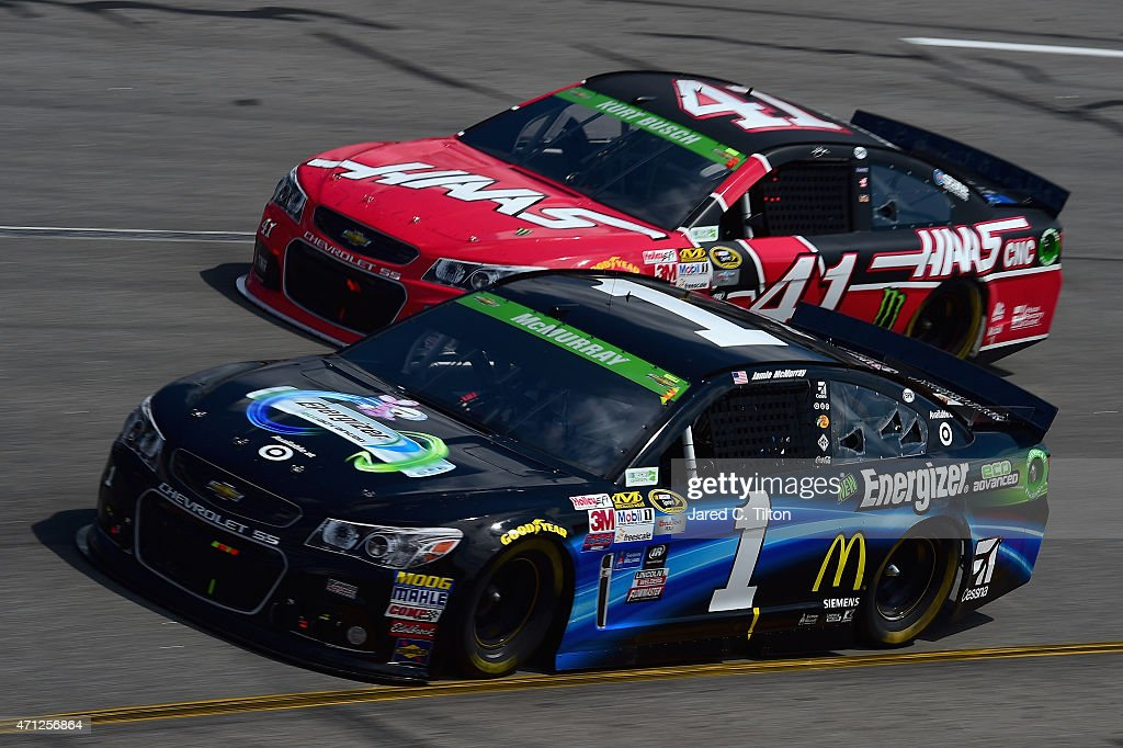 <a gi-track='captionPersonalityLinkClicked' href=/galleries/search?phrase=Jamie+McMurray&family=editorial&specificpeople=198964 ng-click='$event.stopPropagation()'>Jamie McMurray</a>, driver of the #1 Energizer Chevrolet, and <a gi-track='captionPersonalityLinkClicked' href=/galleries/search?phrase=Kurt+Busch&family=editorial&specificpeople=201728 ng-click='$event.stopPropagation()'>Kurt Busch</a>, driver of the #41 Haas Automation Chevrolet, race during the NASCAR Sprint Cup Series Toyota Owners 400 at Richmond International Raceway on April 26, 2015 in Richmond, Virginia.