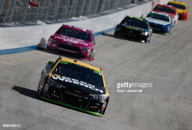 Jamie McMurray driver of the GearWrench Chevrolet leads a pack of cars during the Monster Energy NASCAR Cup Series Apache Warrior 400 presented by...