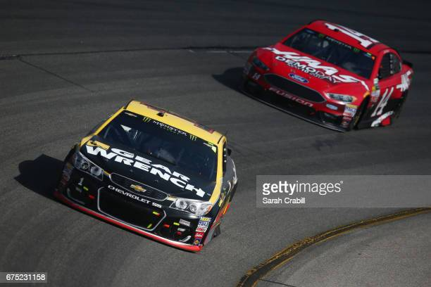 Jamie McMurray driver of the GearWrench Chevrolet leads Clint Bowyer driver of the Haas Automation Demo Days Ford during the Monster Energy NASCAR...