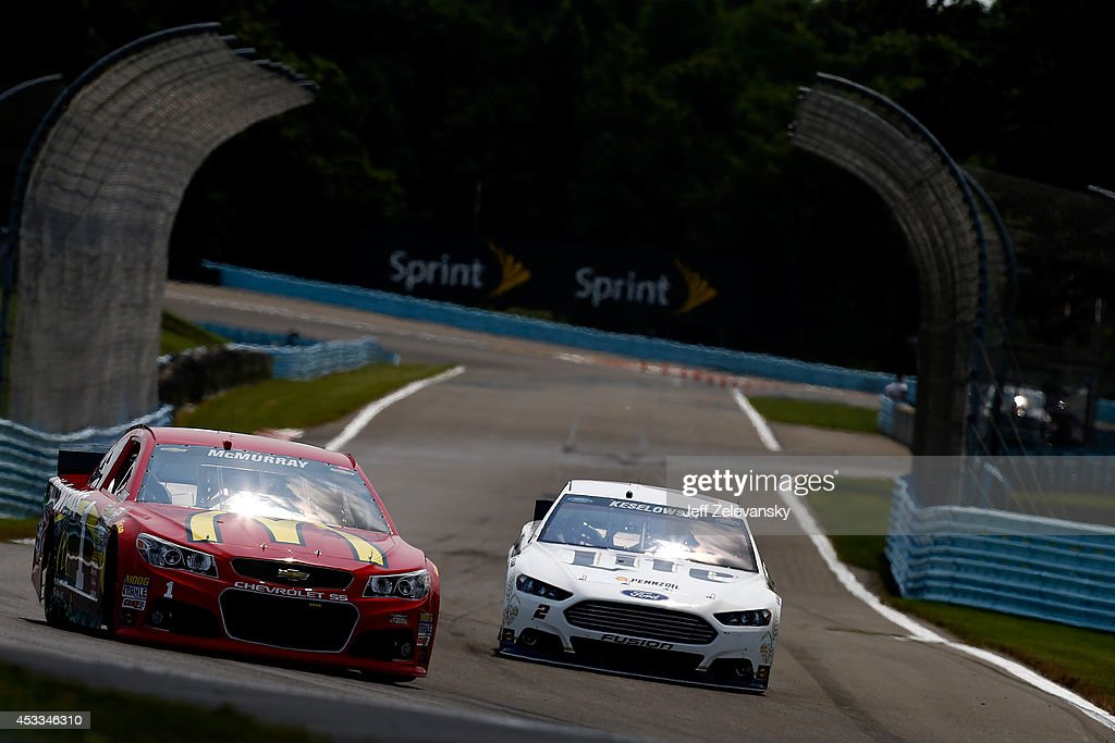 Jamie McMurray, driver of the #1 McDonald's Chevrolet, and Brad Keselowski, driver of the #2 Miller Lite Ford, practice for the NASCAR Sprint Cup Series Cheez-It 355 at Watkins Glen International on August 8, 2014 in Watkins Glen, New York.