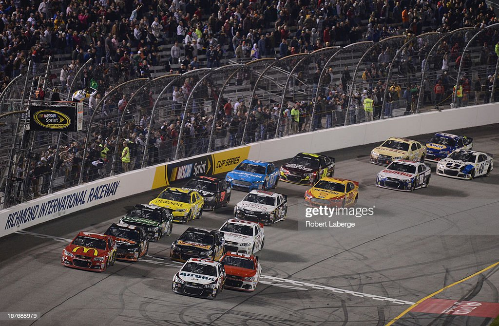 Jamie McMurray, driver of the #1 McDonald's Chevrolet, and Jeff Burton, driver of the #31 Airgas/Bulwark Chevrolet, lead the field to a restart during the NASCAR Sprint Cup Series Toyota Owners 400 at Richmond International Raceway on April 27, 2013 in Richmond, Virginia.