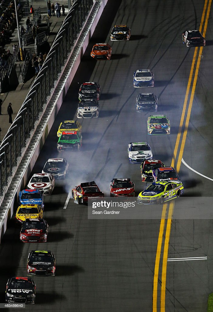Jamie McMurray driver of the McDonald's Chevrolet and Paul Menard driver of the Peak/Menard's Chevrolet spin out in an on track incident during the...