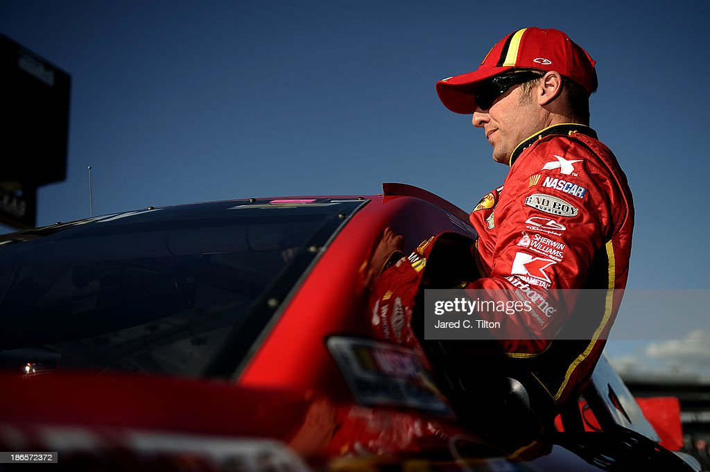 Jamie McMurray, driver of the #1 McDonald's Chevrolet, climbs from his car after qualifying for the NASCAR Sprint Cup Series AAA Texas 500 at Texas Motor Speedway on November 1, 2013 in Fort Worth, Texas.
