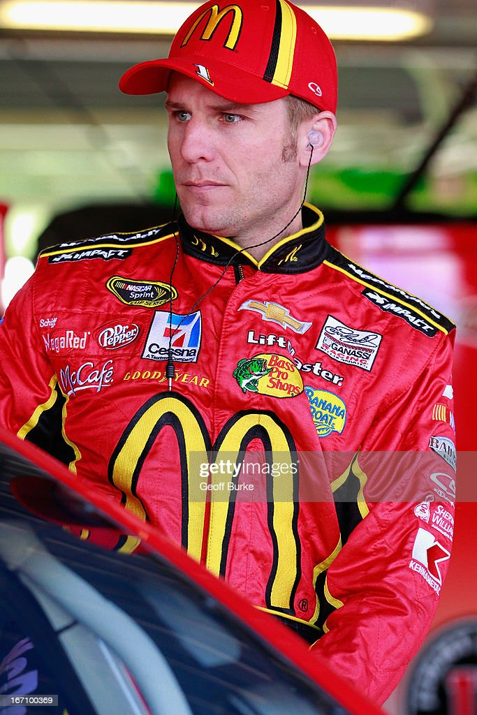 Jamie McMurray, driver of the #1 McDonald's Chevrolet, climbs into his car prior to practice for the NASCAR Sprint Cup Series STP 400 at Kansas Speedway on April 20, 2013 in Kansas City, Kansas.