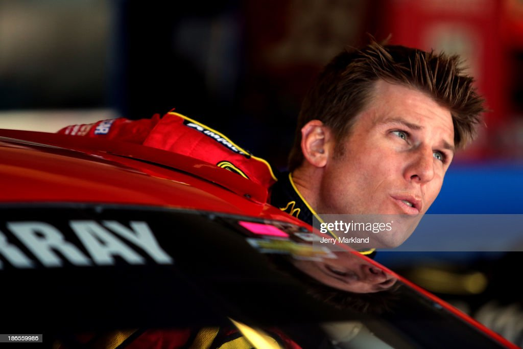 Jamie McMurray, driver of the #1 McDonald's Chevrolet, climbs into his car in the garage area during practice for the NASCAR Sprint Cup Series AAA Texas 500 at Texas Motor Speedway on November 1, 2013 in Fort Worth, Texas.
