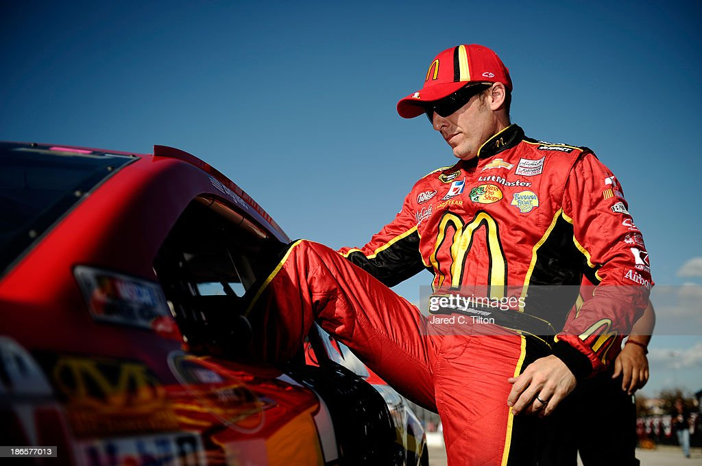 Jamie McMurray, driver of the #1 McDonald's Chevrolet, climbs out of his car after qualifying for the NASCAR Sprint Cup Series AAA Texas 500 at Texas Motor Speedway on November 1, 2013 in Fort Worth, Texas.