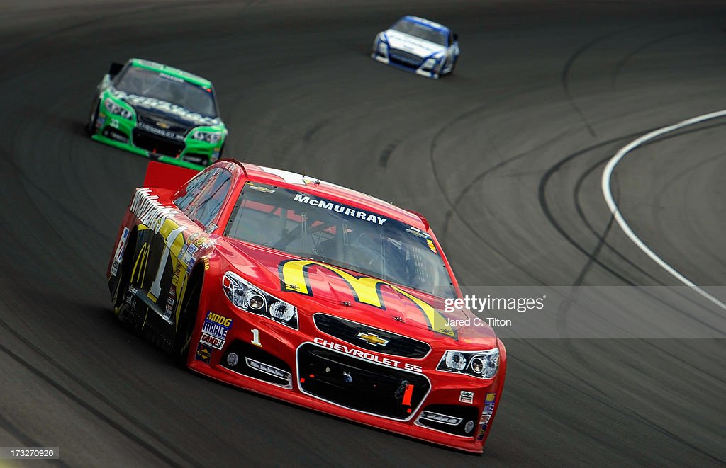 Jamie McMurray, driver of the #1 McDonald's Chevrolet, drives during the NASCAR Sprint Cup Series Quicken Loans 400 at Michigan International Speedway on June 16, 2013 in Brooklyn, Michigan.