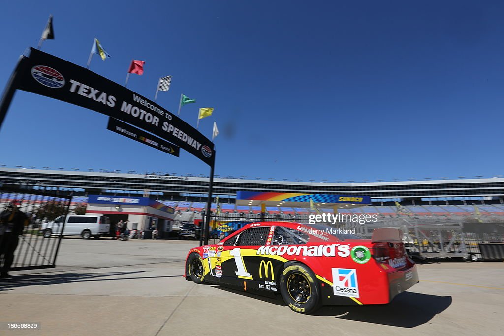 Jamie McMurray, driver of the #1 McDonald's Chevrolet, drives through the garage area during practice for the NASCAR Sprint Cup Series AAA Texas 500 at Texas Motor Speedway on November 1, 2013 in Fort Worth, Texas.