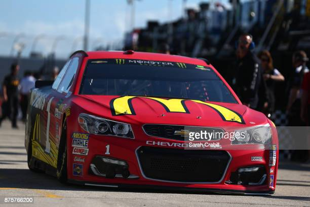 Jamie McMurray driver of the McDonald's Chevrolet drives through the garage area during practice for the Monster Energy NASCAR Cup Series...
