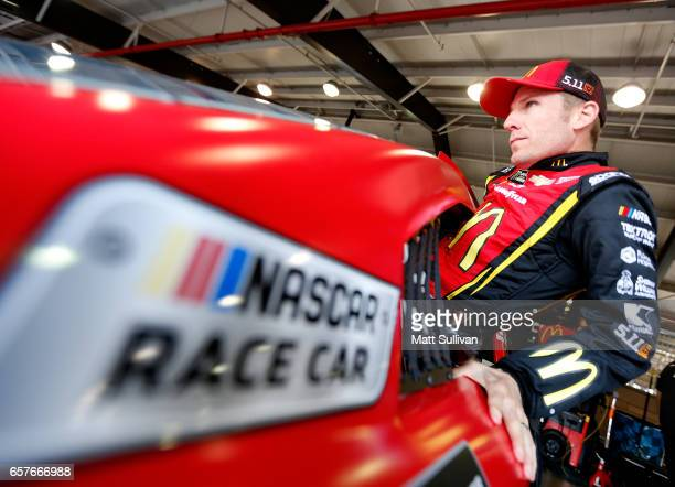 Jamie McMurray driver of the McDonald's Chevrolet gets into his car during practice for the Monster Energy NASCAR Cup Series Auto Club 400 at Auto...