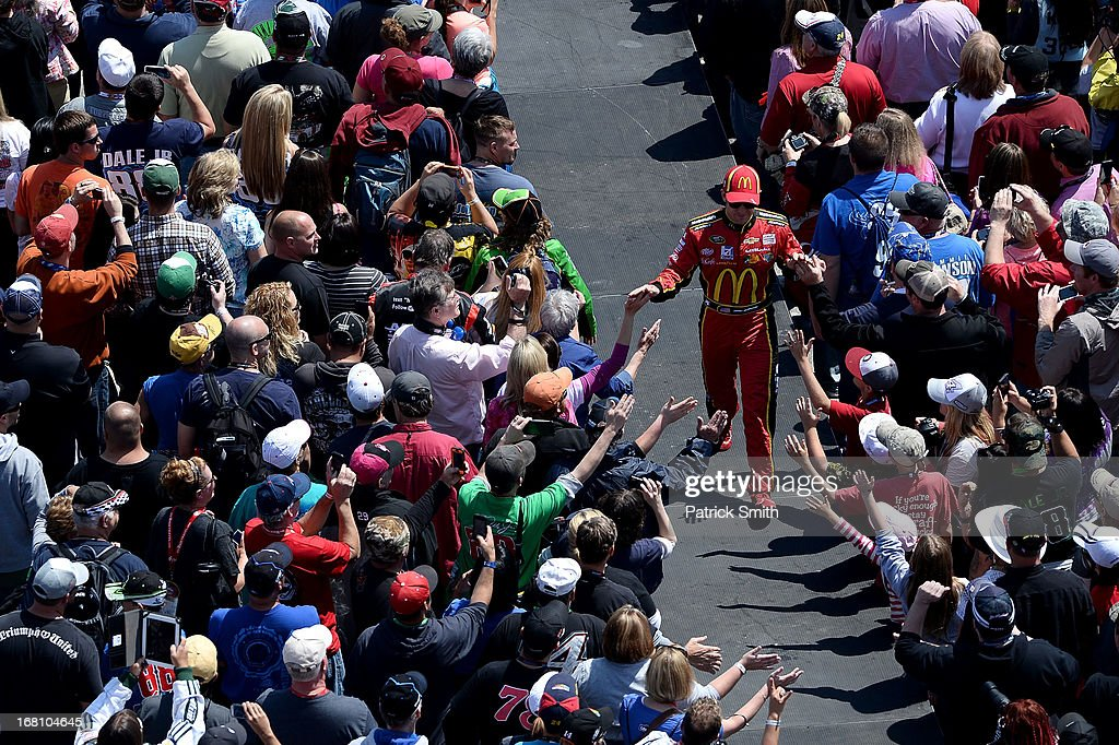 Jamie McMurray, driver of the #1 McDonald's Chevrolet, greets fans during driver introductions prior to the start of the NASCAR Sprint Cup Series Aaron's 499 at Talladega Superspeedway on May 5, 2013 in Talladega, Alabama.
