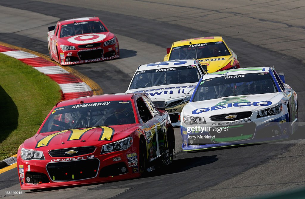 Jamie McMurray, driver of the #1 McDonald's Chevrolet, leads a pack of cars during the NASCAR Sprint Cup Series Cheez-It 355 at Watkins Glen International on August 10, 2014 in Watkins Glen, New York.