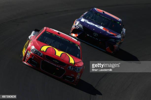 Jamie McMurray driver of the McDonald's Chevrolet leads Denny Hamlin driver of the FedEx Office Toyota during the Monster Energy NASCAR Cup Series...