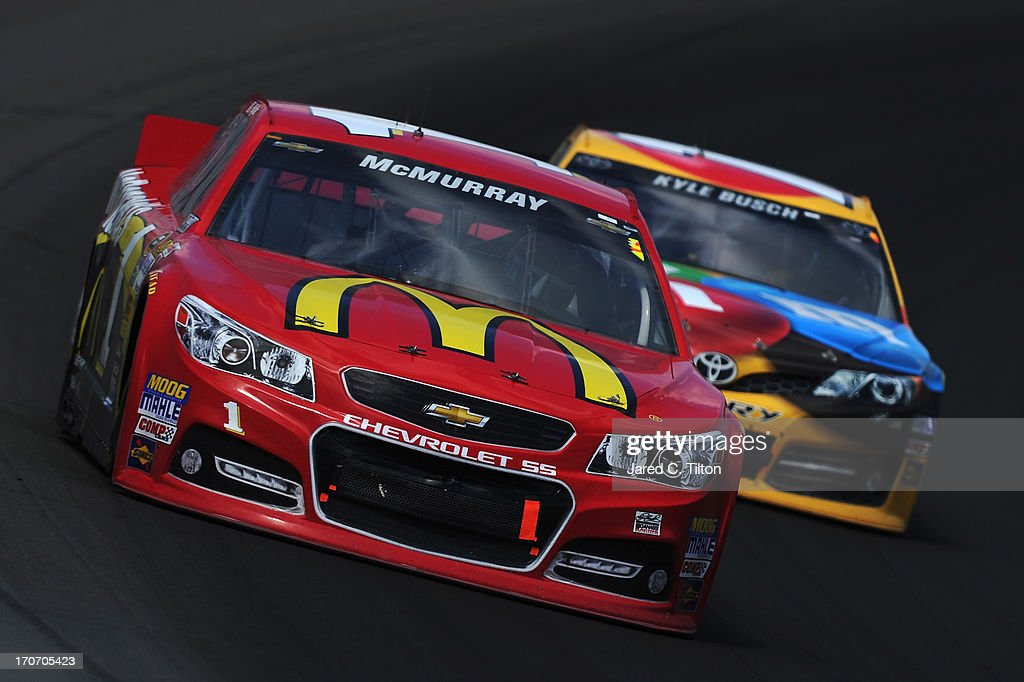 Jamie McMurray, driver of the #1 McDonald's Chevrolet, leads Kyle Busch, driver of the #18 M&M's Toyota, during the NASCAR Sprint Cup Series Quicken Loans 400 at Michigan International Speedway on June 16, 2013 in Brooklyn, Michigan.